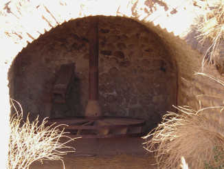 Remains of the mission buildings include a water-driven wheel used to power a mill.